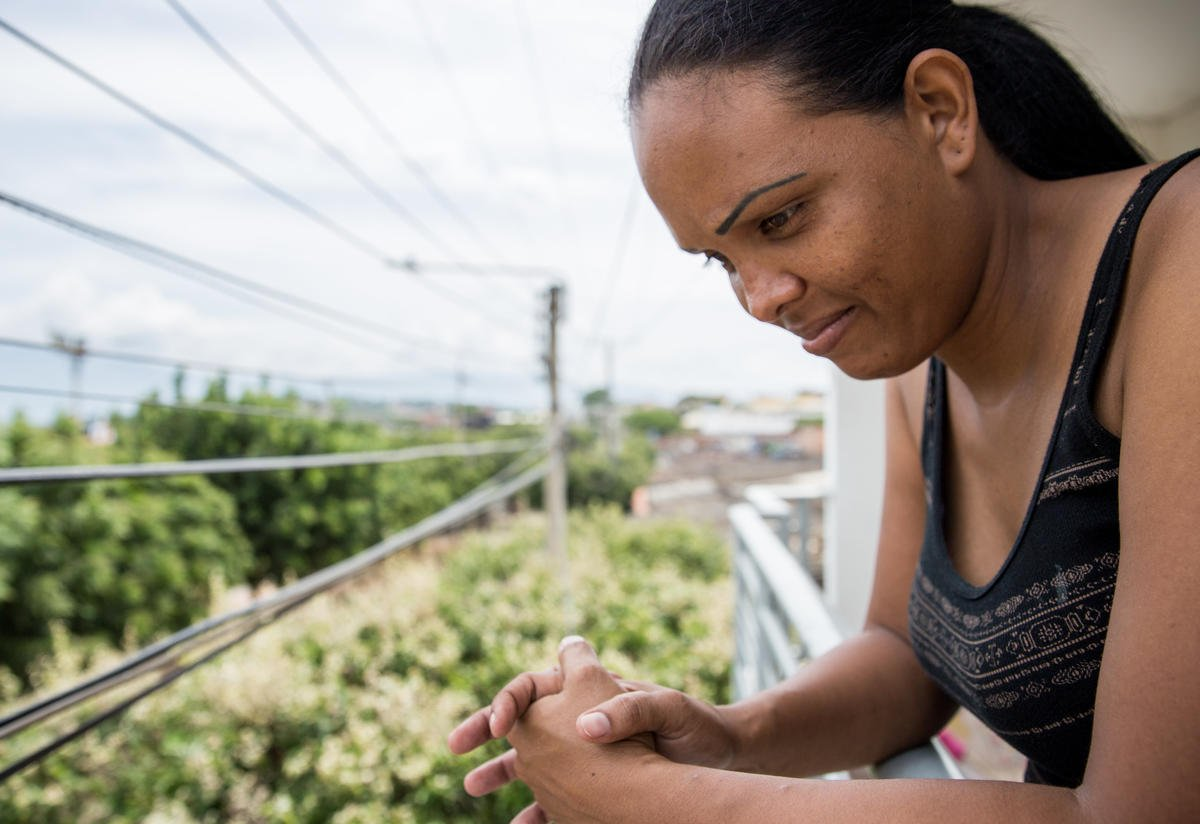 Cibel Ortiz looks out over a balcony in Cúcuta, Colombia.