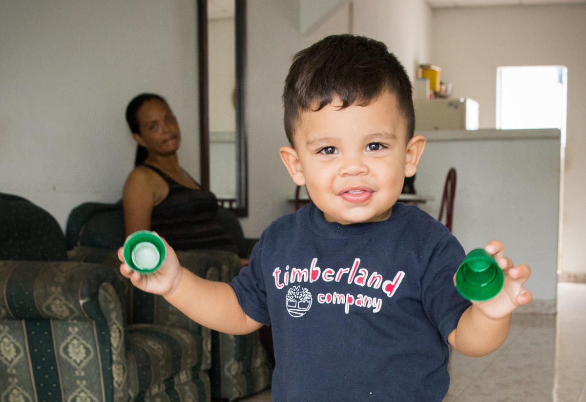 Matías with his mother Cibel at home