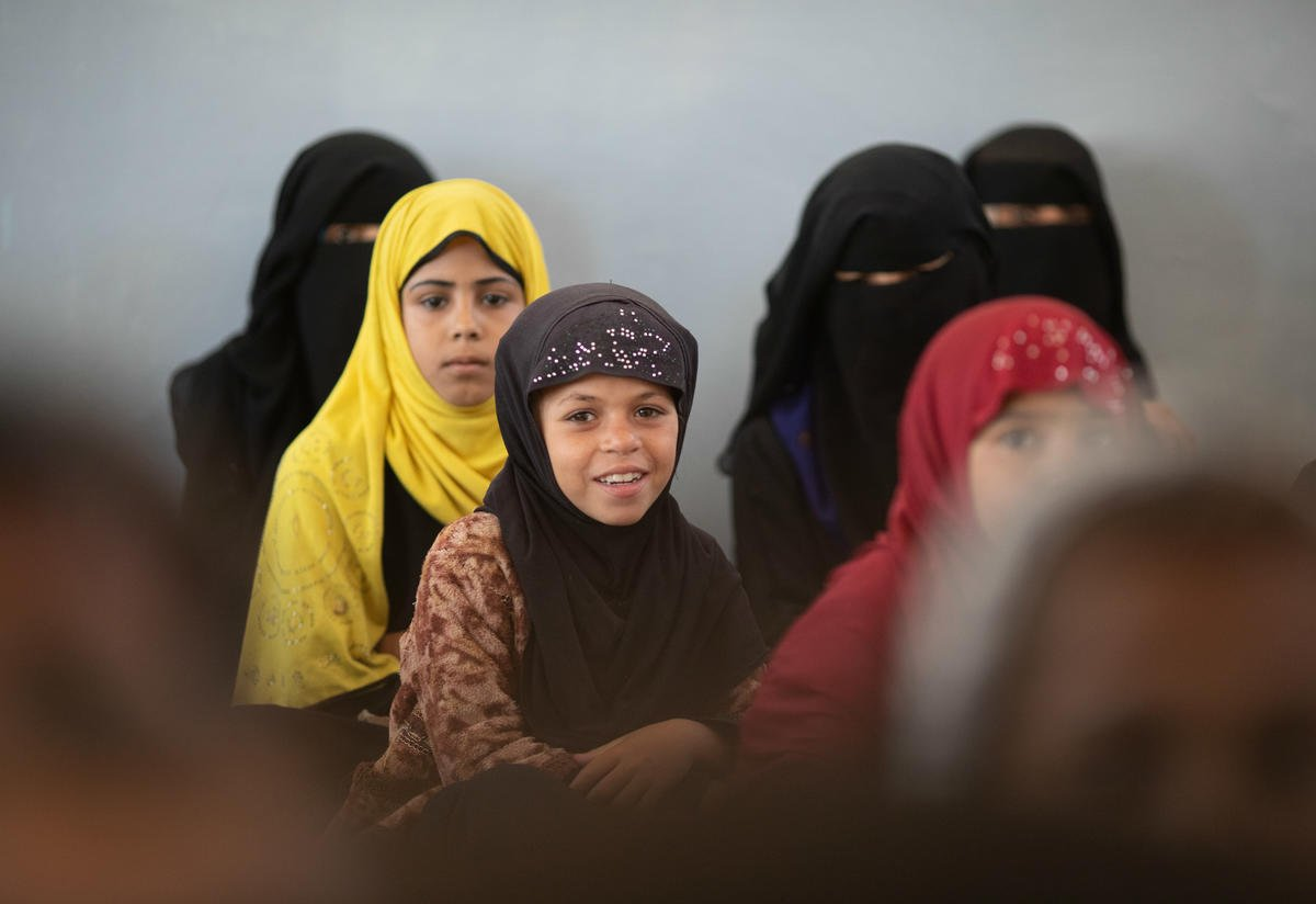 Girls sit in class at their local school in the isolated village of Al Rukbah, Adhale Governorate, Yemen