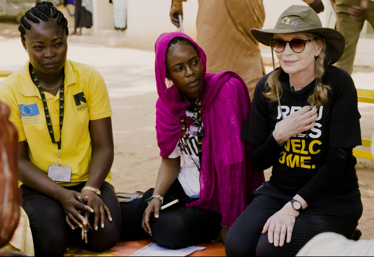 Actress and voice for the International Rescue Committee Mia Farrow joins IRC staff at a malnutrition education session for families in Chad.
