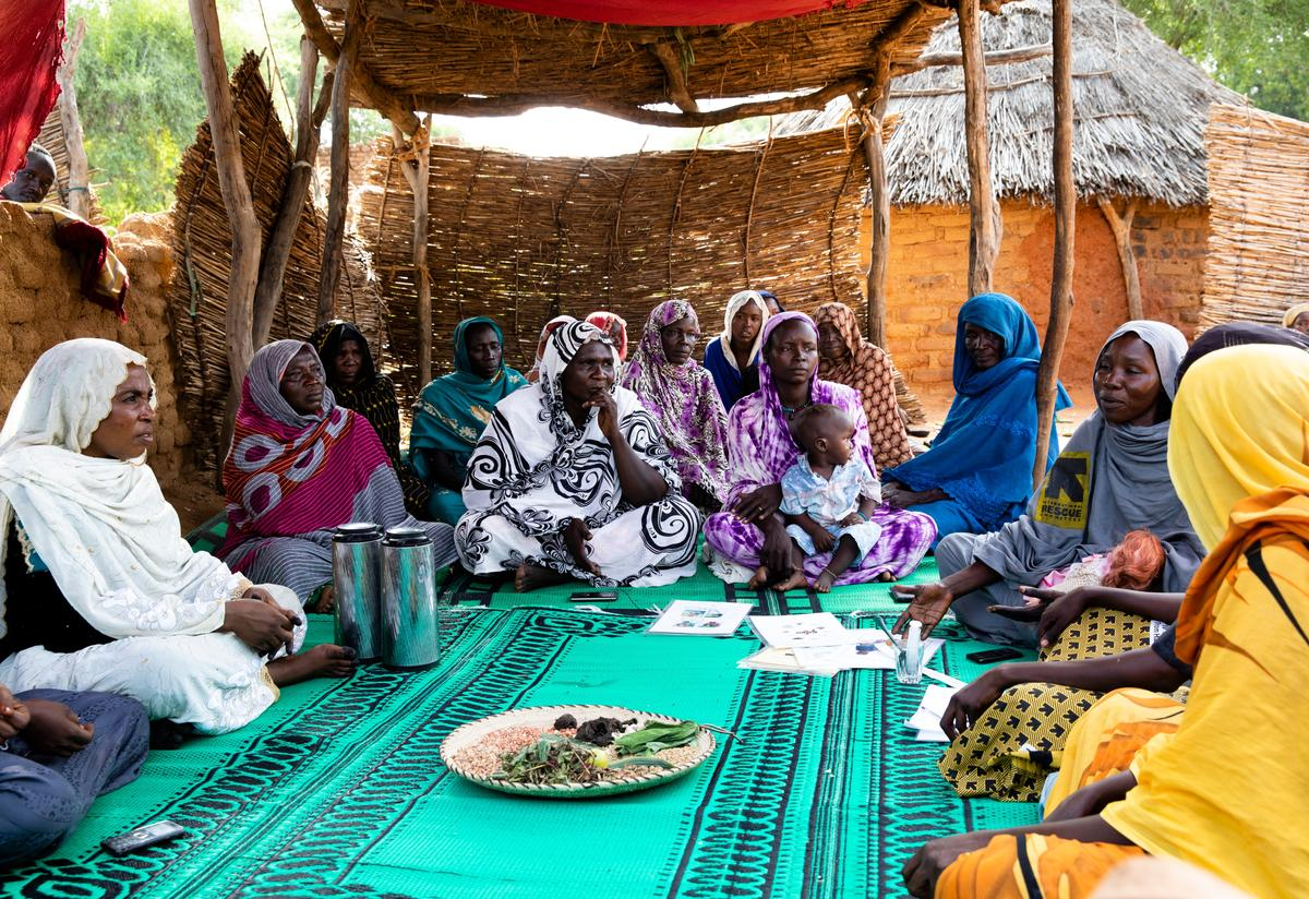 An International Rescue Committee community health worker in a village in Chad teaches families how to prepare extra-nutritious foods for their children to avoid malnutrition.