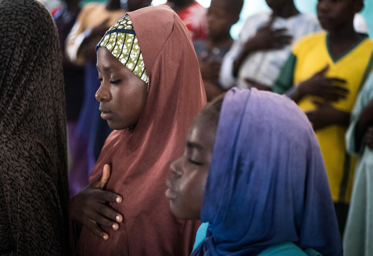 Two girls practice deep breathing techniques in their classroom at at an International Rescue Committee supported school in Nigeria.