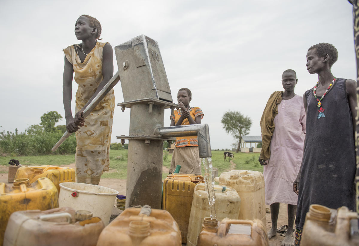 South Sudanese women pump water