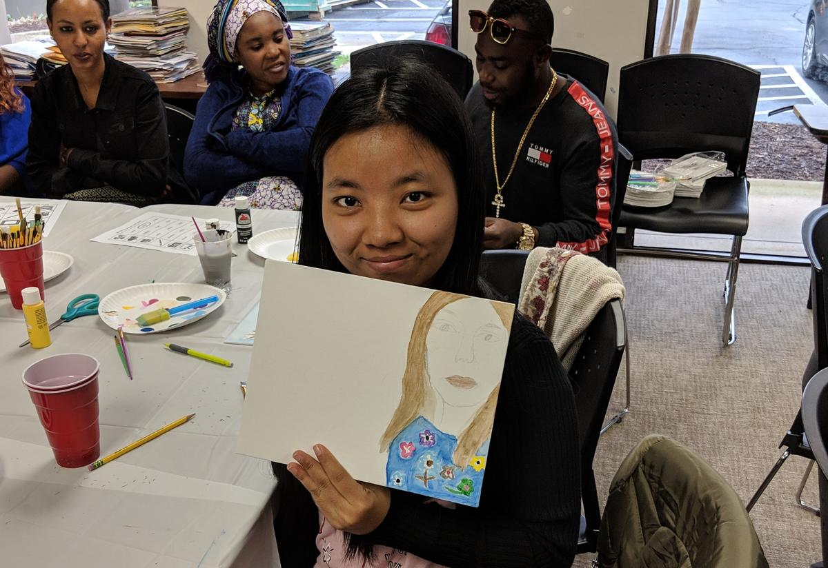 Students paint portraits of the important women in their lives.