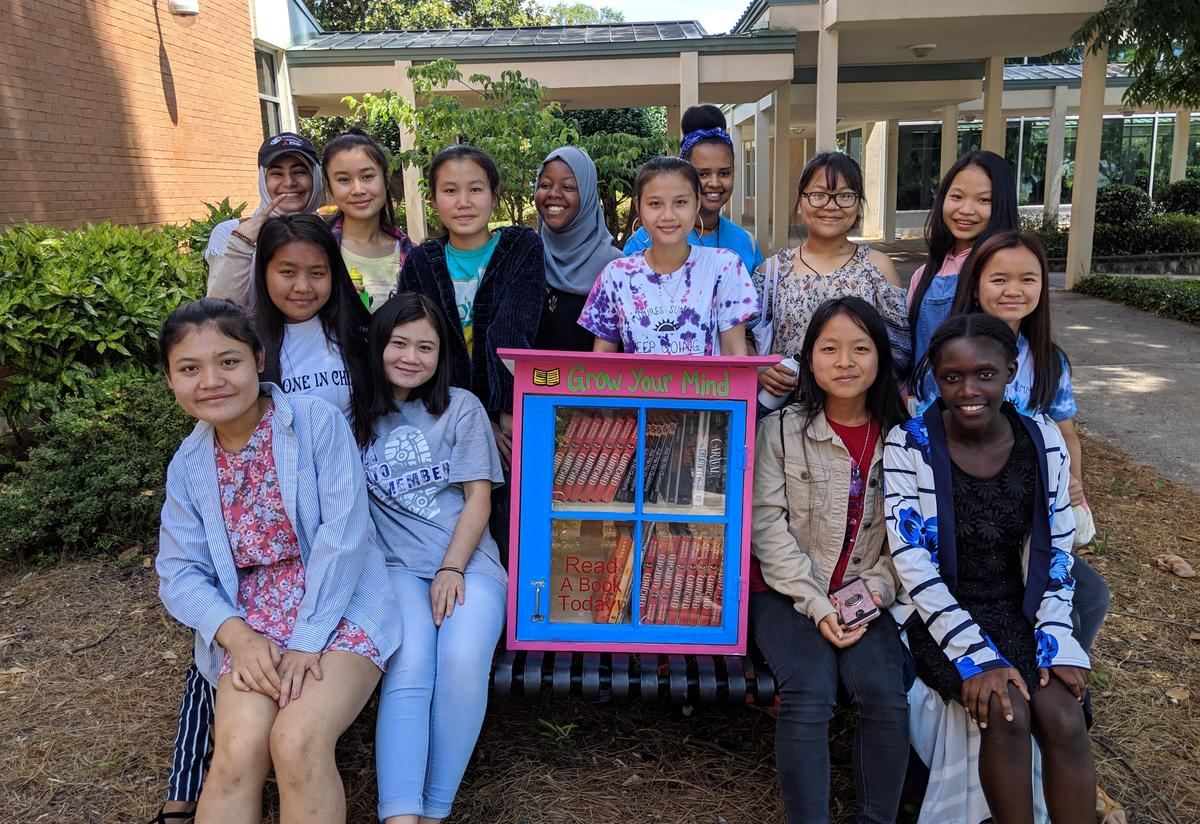 Ready, Set, College! summer camp students with their finished Little Free Library!