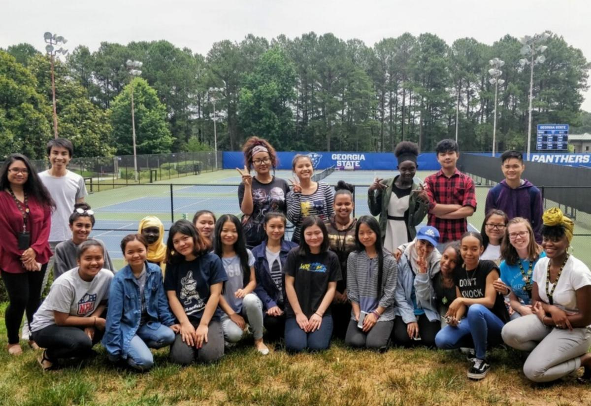 Summer camp students take a group picture in front of the GSU sign.