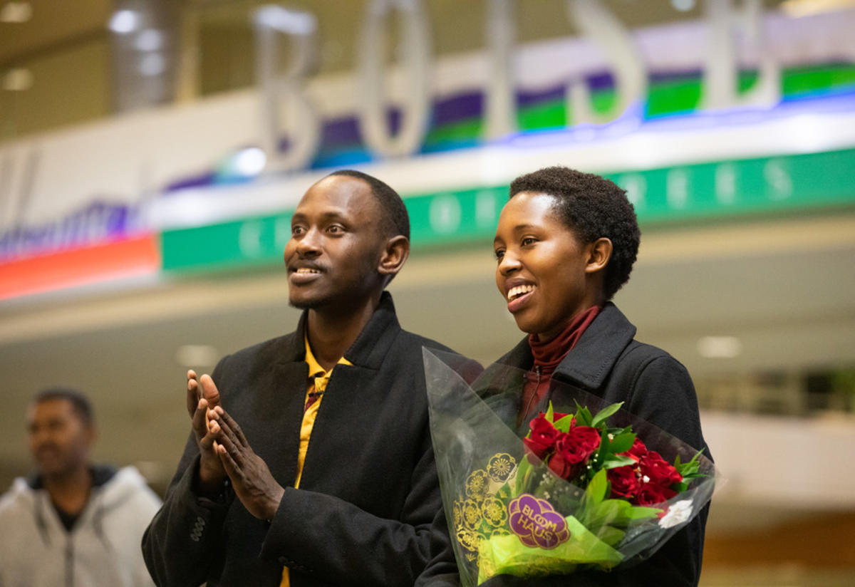 Congolese refugees wait at Boise Airport to be reunited with family