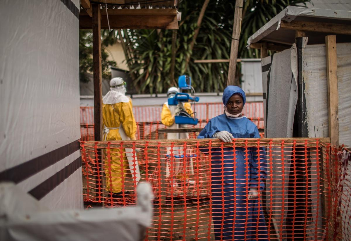 An Ebola survivor wears scrubs at an IRC-supported Ebola Treatment Center at Beni Hospital, in the Democratic Republic of Congo.