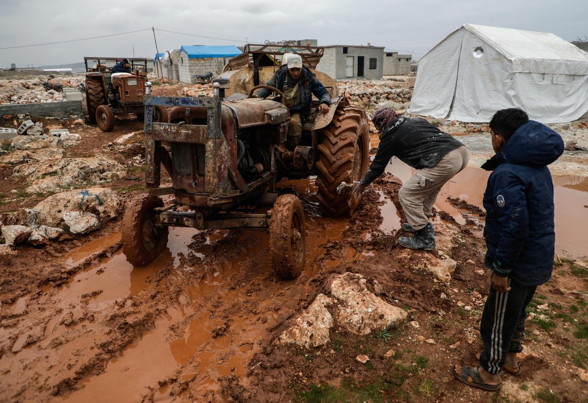 Tractor in informal settlement in Deir Hassan in northwest Idlib gets stuck in the mud
