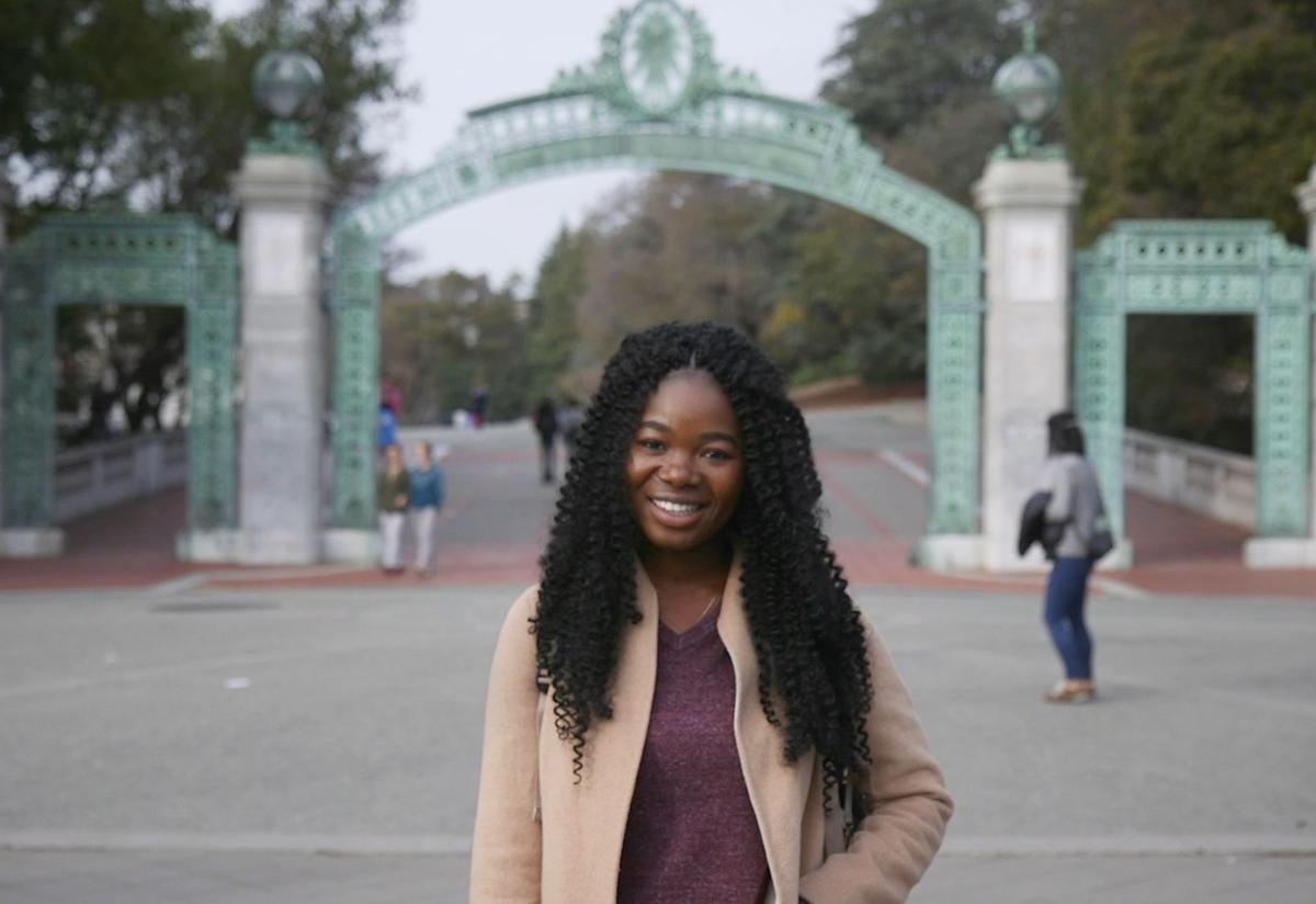 Torbertha Torbor poses in front of UC Berkeley
