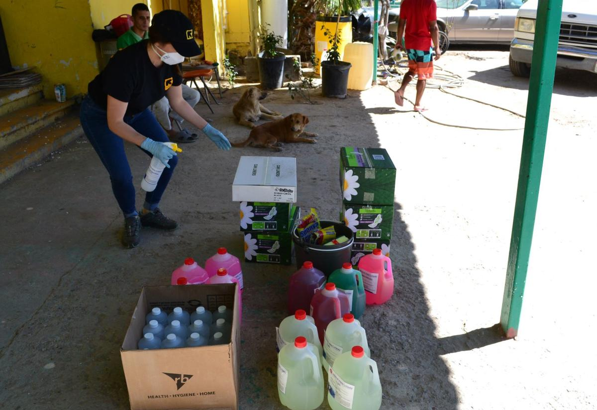 An IRC staff member stands above buckets of cleaning supplies to be delivered to shelters in Ciudad Juárez, Mexico.