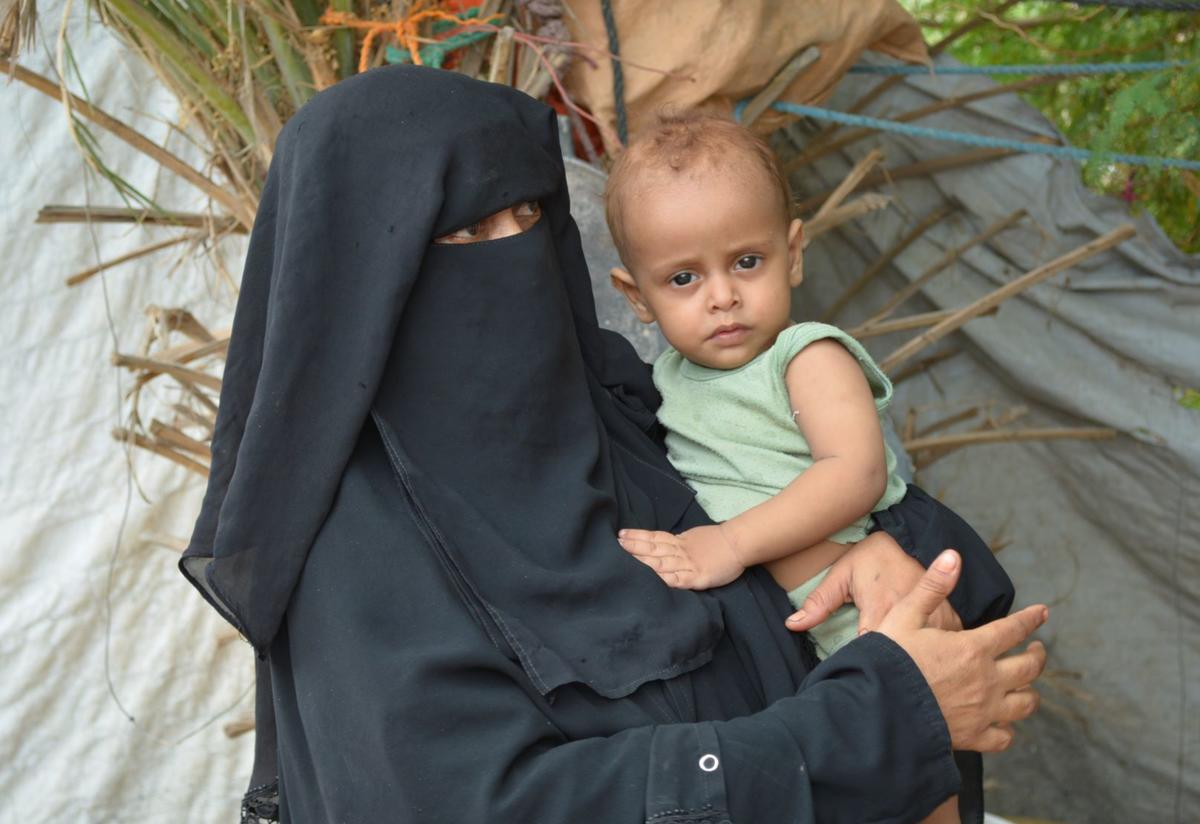 Fathiah Said Saleh Naji, an IRC client, poses with her child in Aden, Yemen.