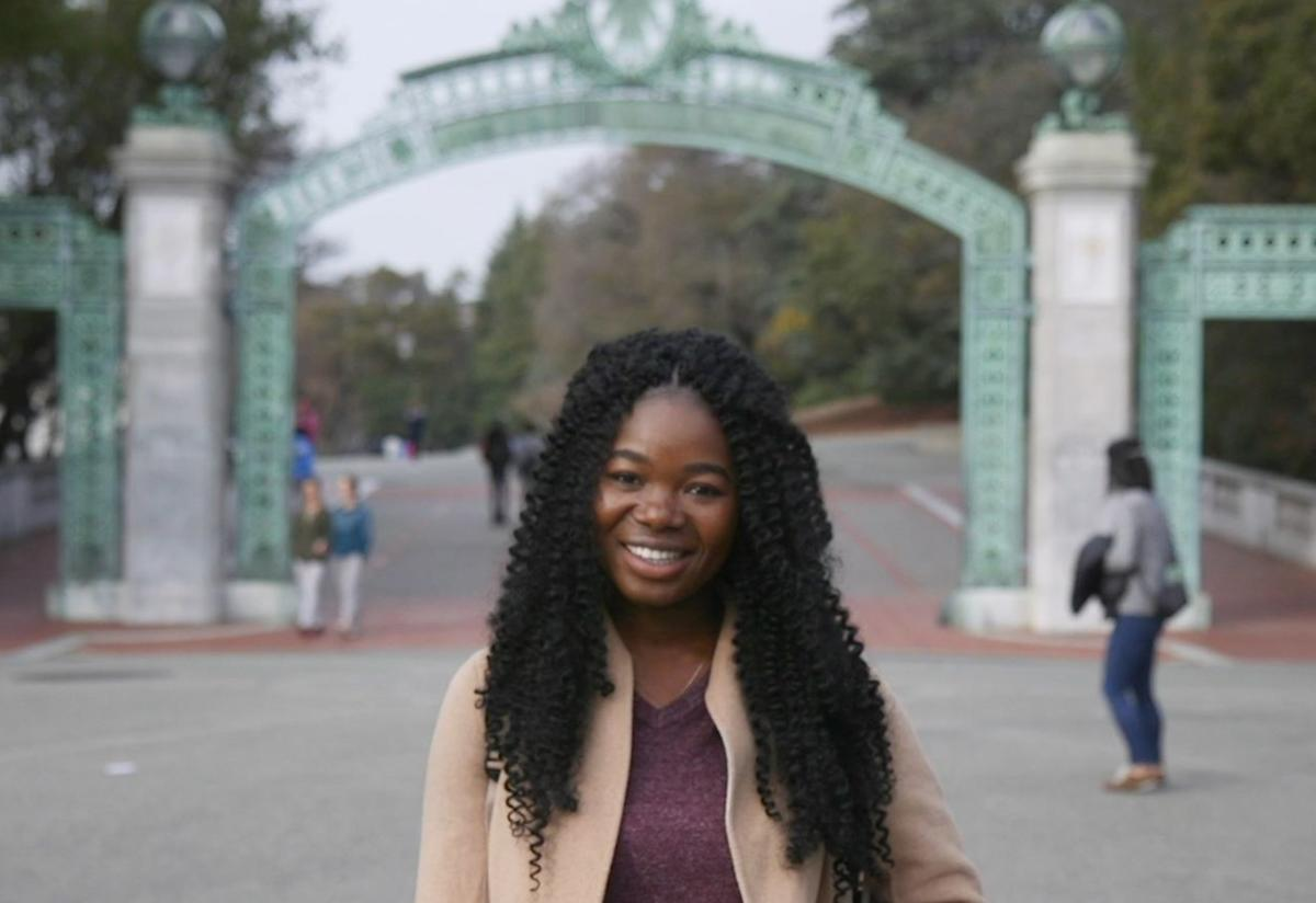 Torbertha Torbor stands outside the front gate at the University of California at Berkeley