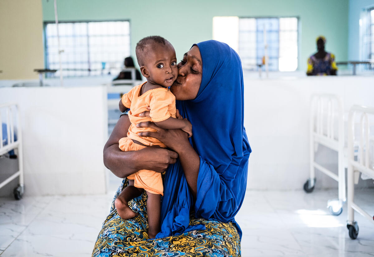 Binta holds her baby boy Ali at an IRC health center in Nigeria where he was being treated for acute malnutrition