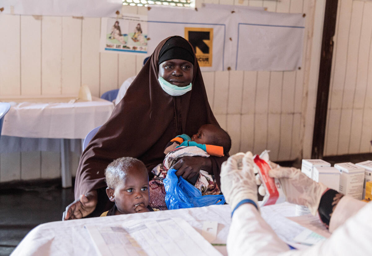 Amina with her children at an IRC health center where the staff treats children for malnutrition