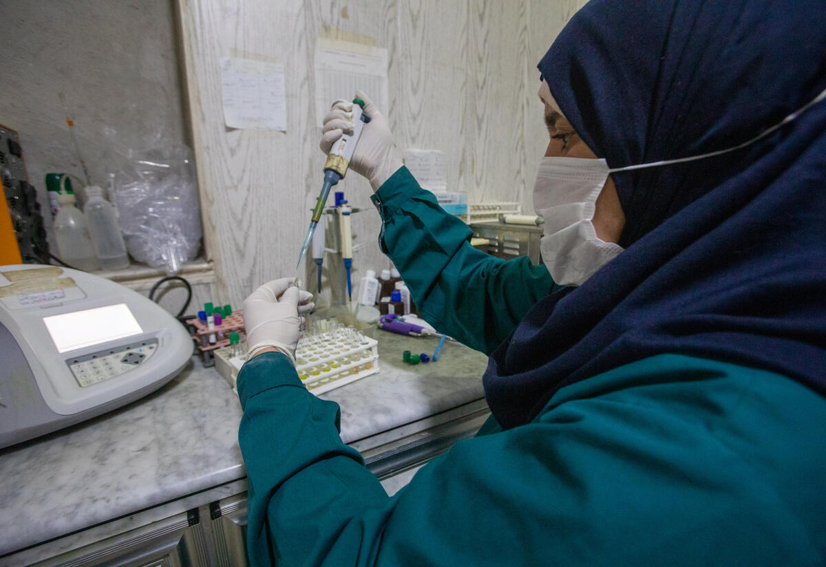 A lab technician analyzing a blood test at Idlib Surgical Hospital, a hospital supported by the IRC in northwest Syria. PHOTO: Khaled Idlbe/IRC