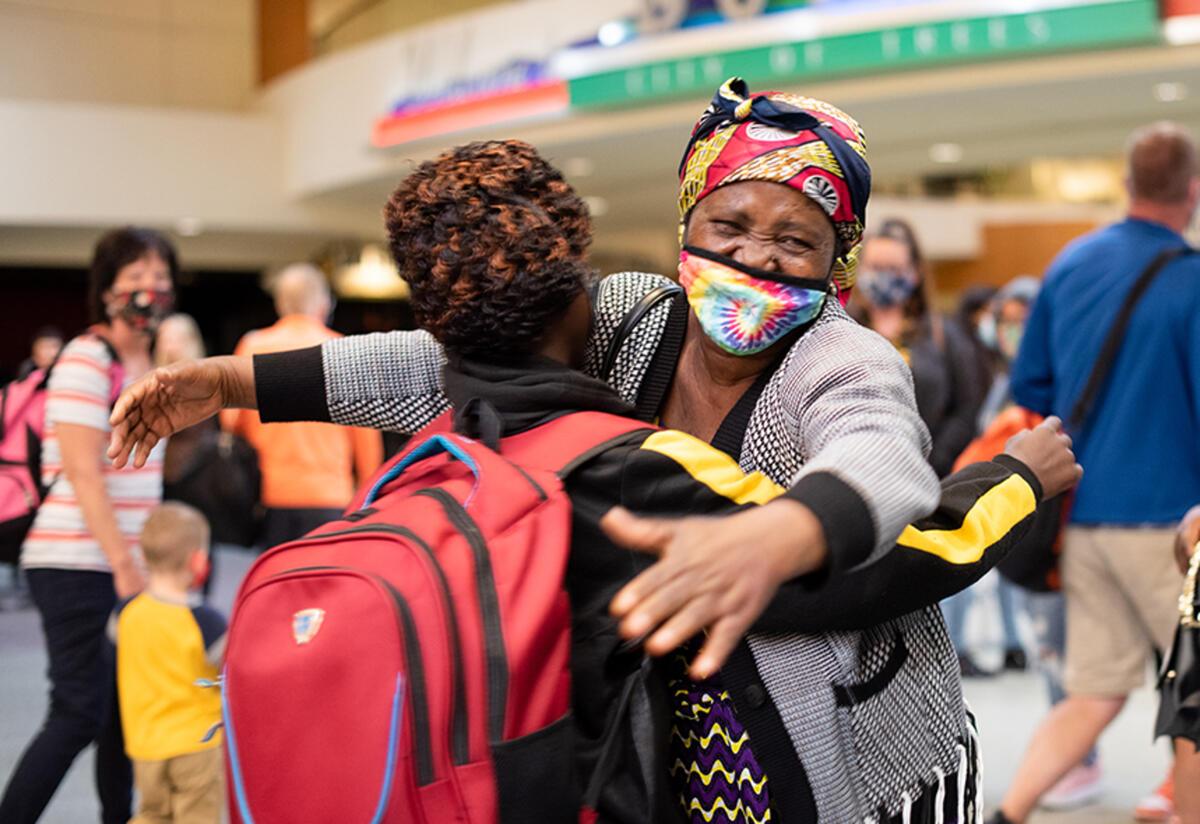Wanyema hugs one of her grandchildren