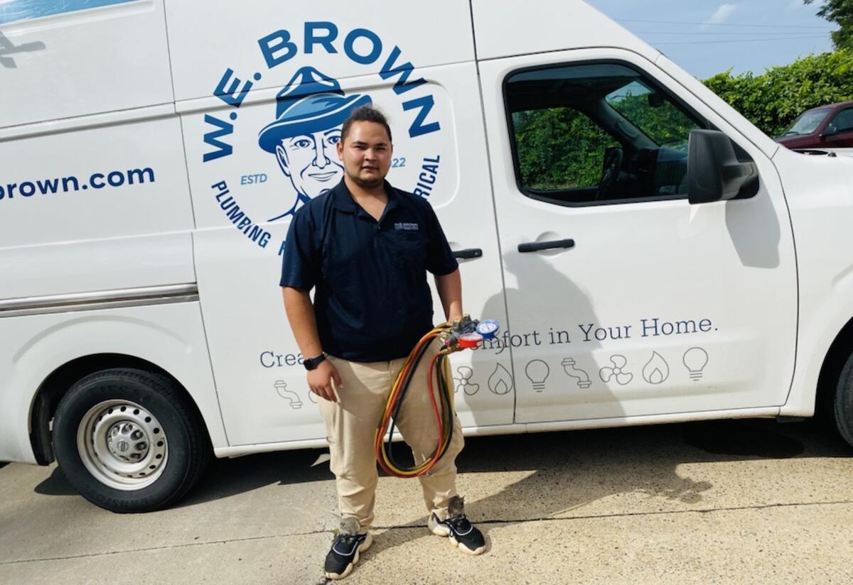 Ali in front of W.E. Brown van