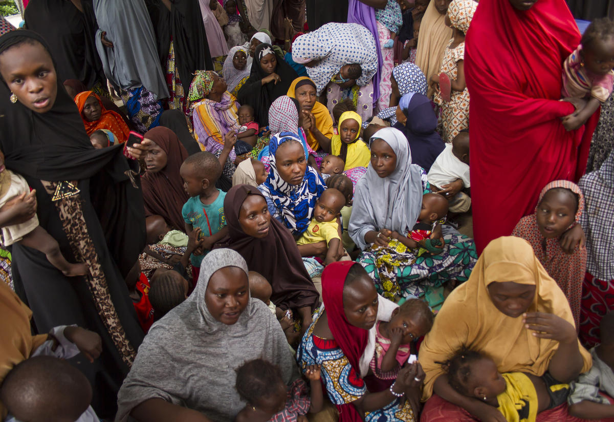 Women and children visit an IRC mobile medical team