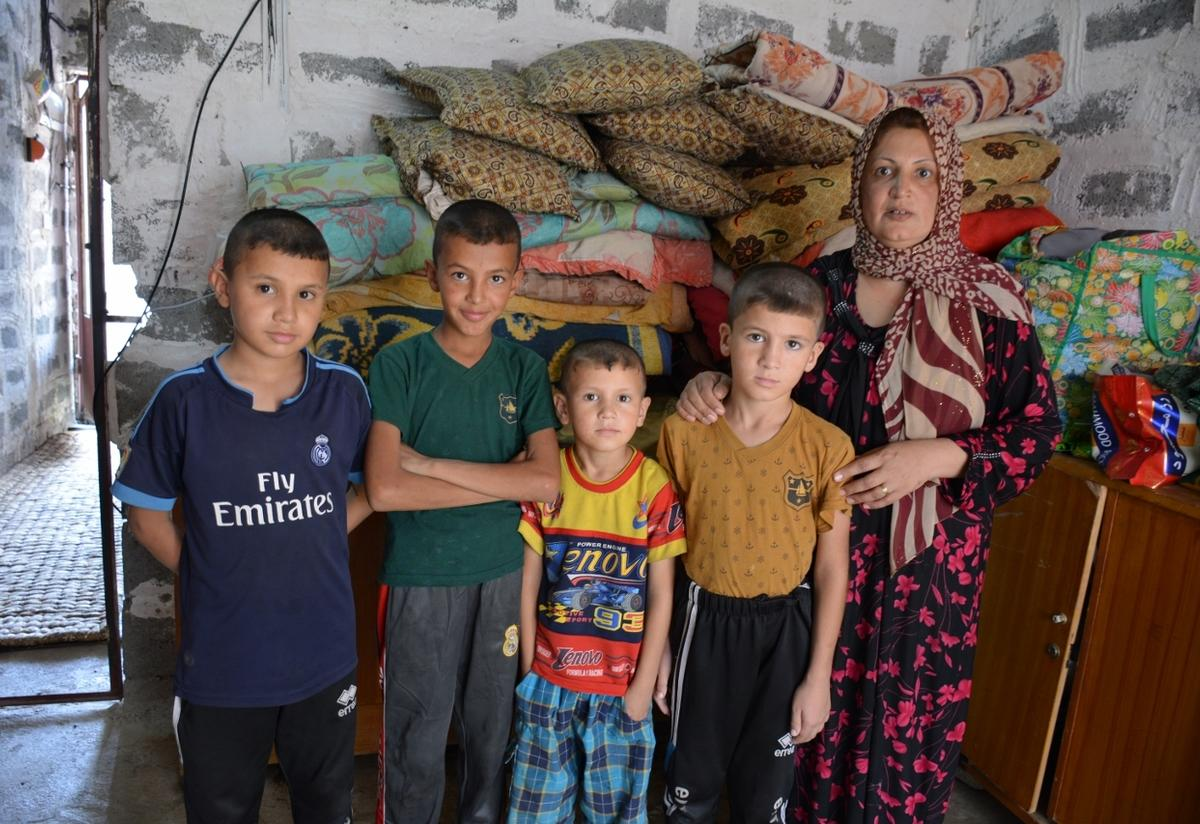 Displaced Iraqi mother with her four sons