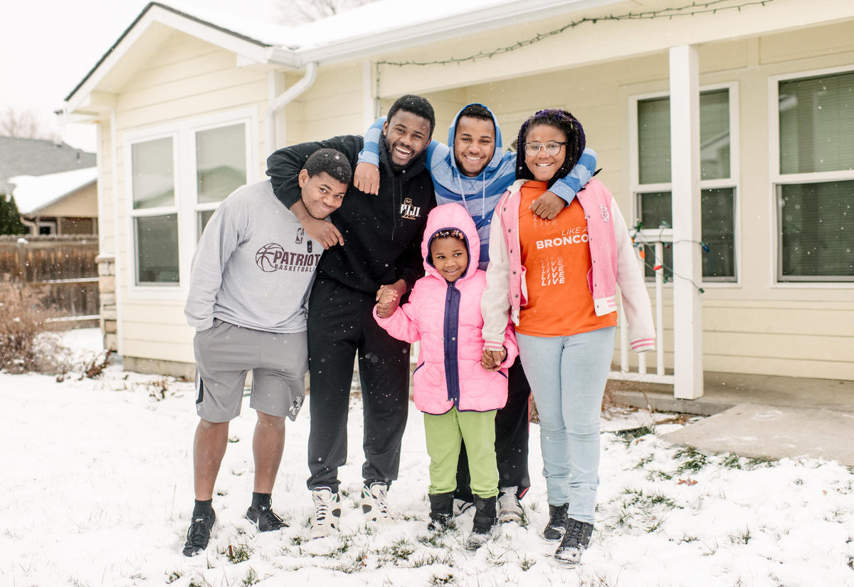 The Ngalamulume siblings pose for a photo in the snow in the front yard of their home in Boise.