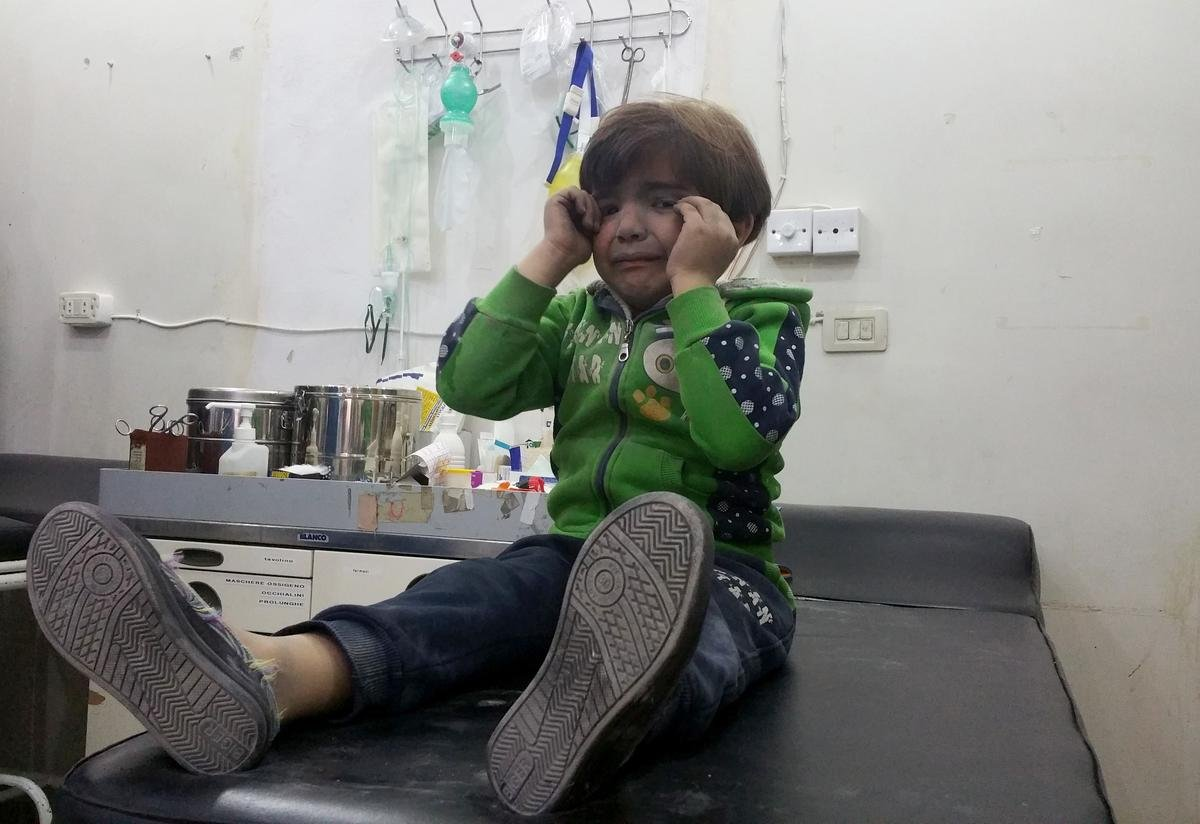 A Syrian child receives treatment at a hospital after chemical attack