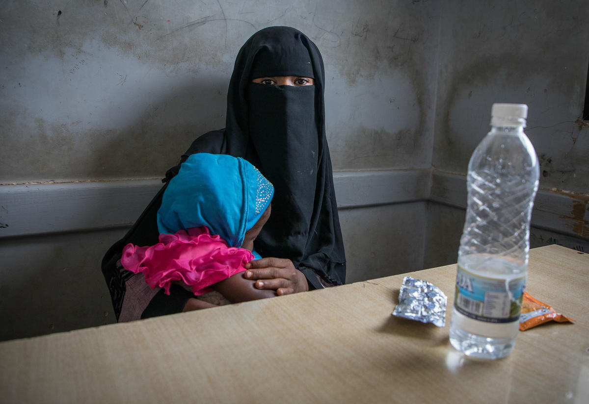 A woman and child at an IRC health clinic in Yemen