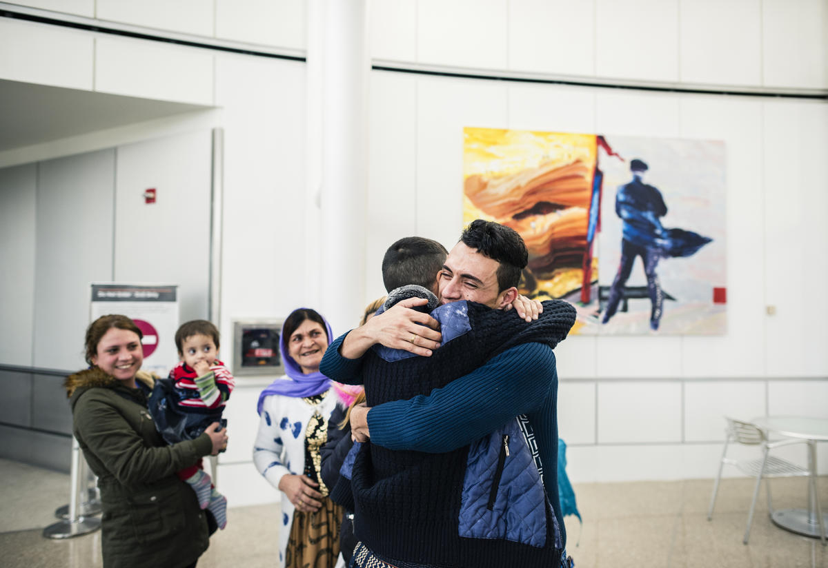 Adil Kheder Nimr, a Yazidi refugee, was reunited with his family on February 10. in Tukwila, Washington after they were banned from entering the U.S.