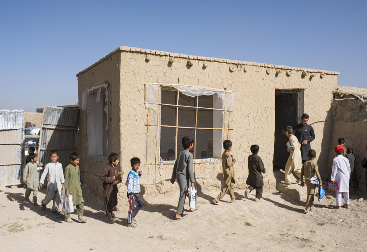 Afghan boys line up and enter their primary school