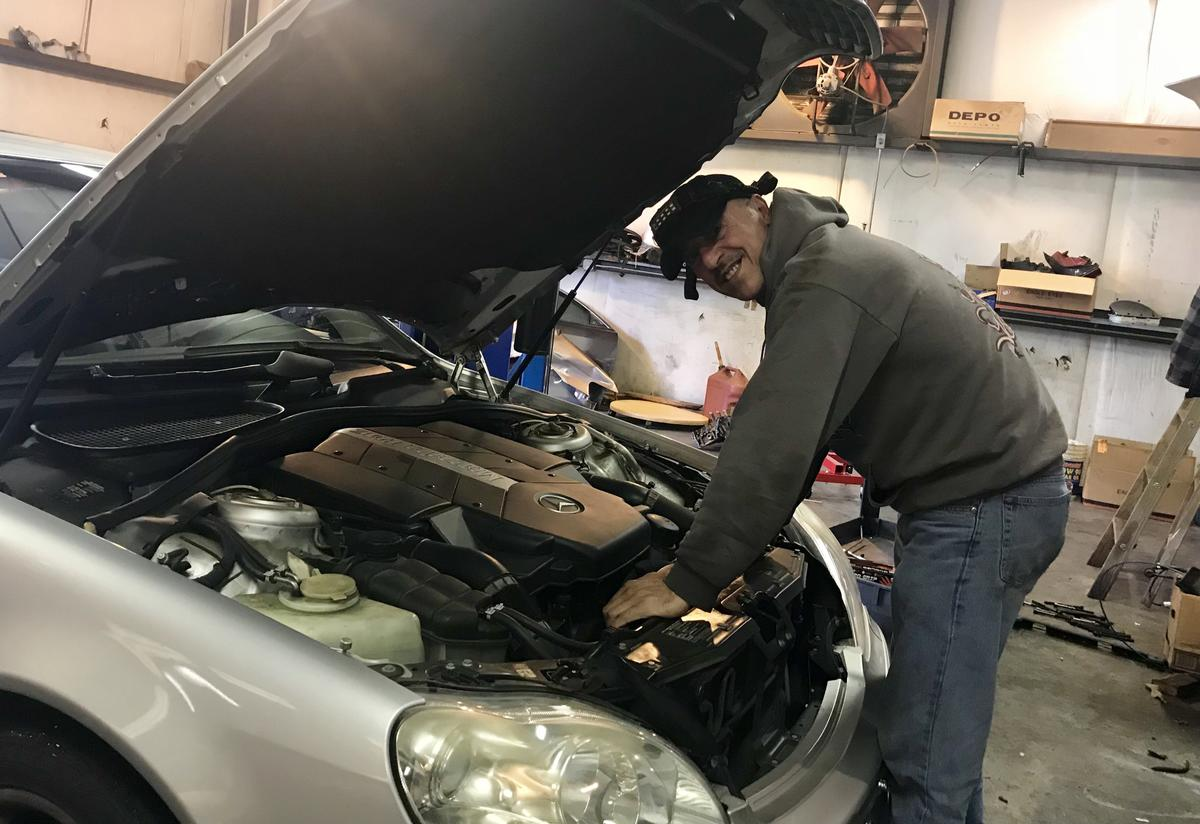 Mohammad at work at The Best Works Auto Care Center in Roswell.