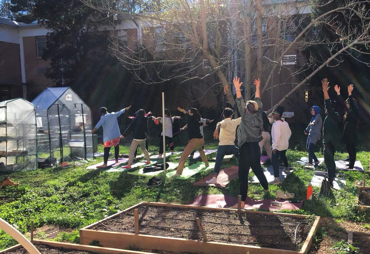 Enjoying yoga class in the Clarkston High School garden.
