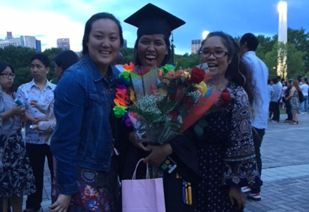 San at her Clarkston High School Graduation with Ms. Sharita and Ms. Daisy.