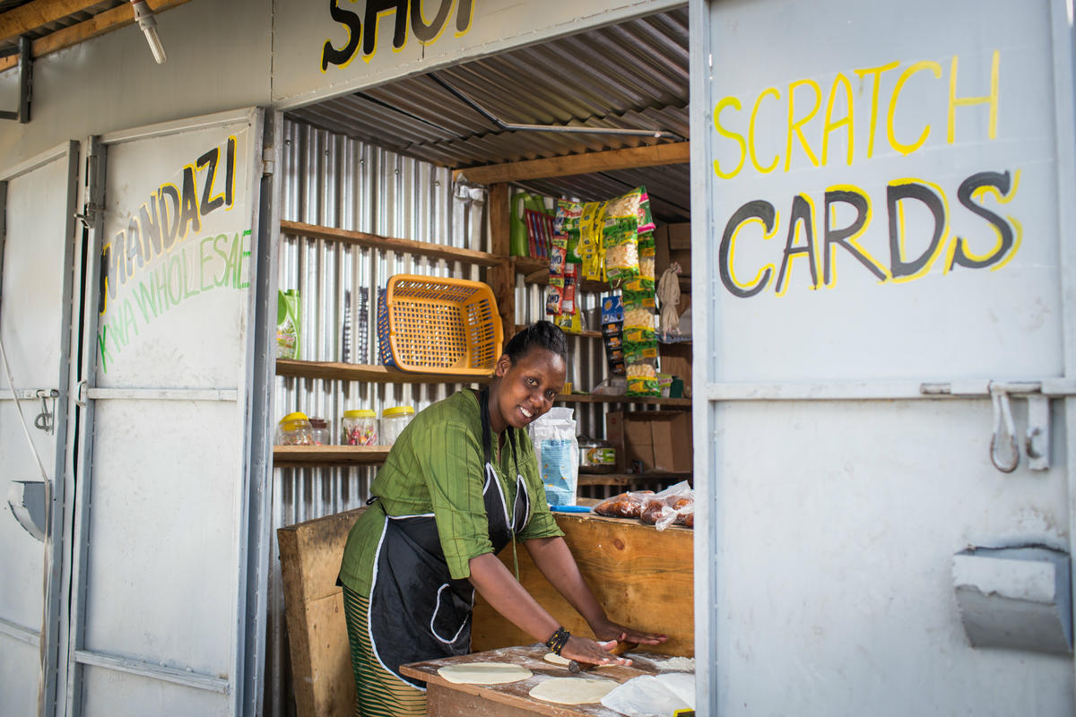 Chantal Rutonda Nyamuco prepares dough to make bread in her small mandazi stall in Nairobi.