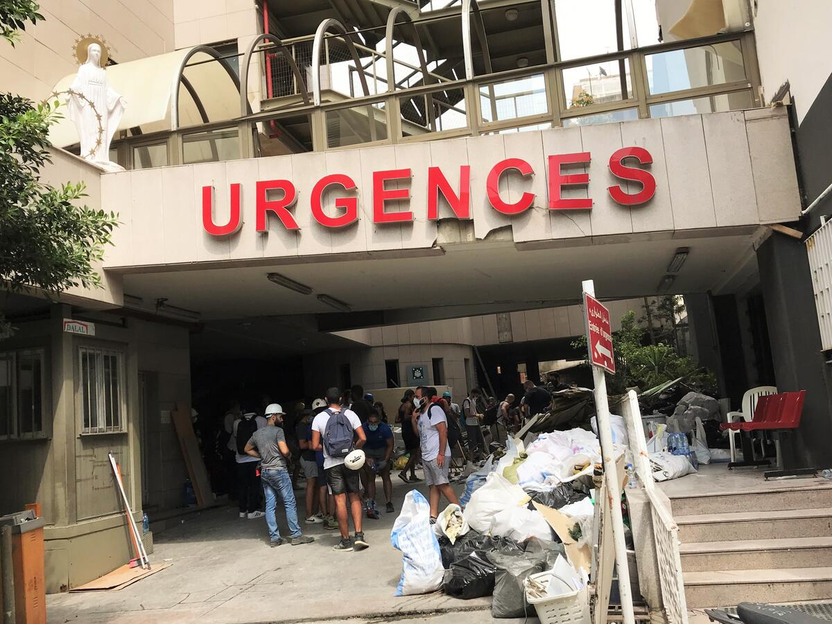 People gather outside a hospital emergency room in Beirut, Lebanon after the explosion
