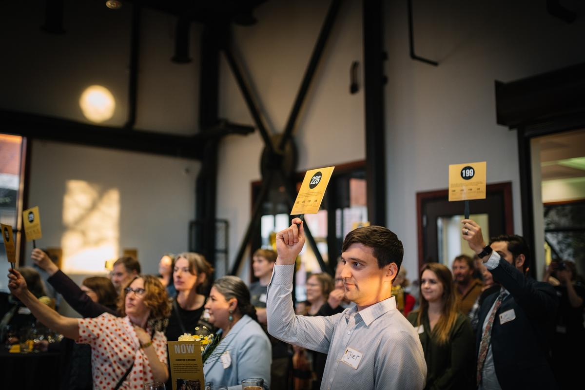 Attendees raised over $6,500 for the International Rescue Committee in Salt Lake City during the symbolic live auction