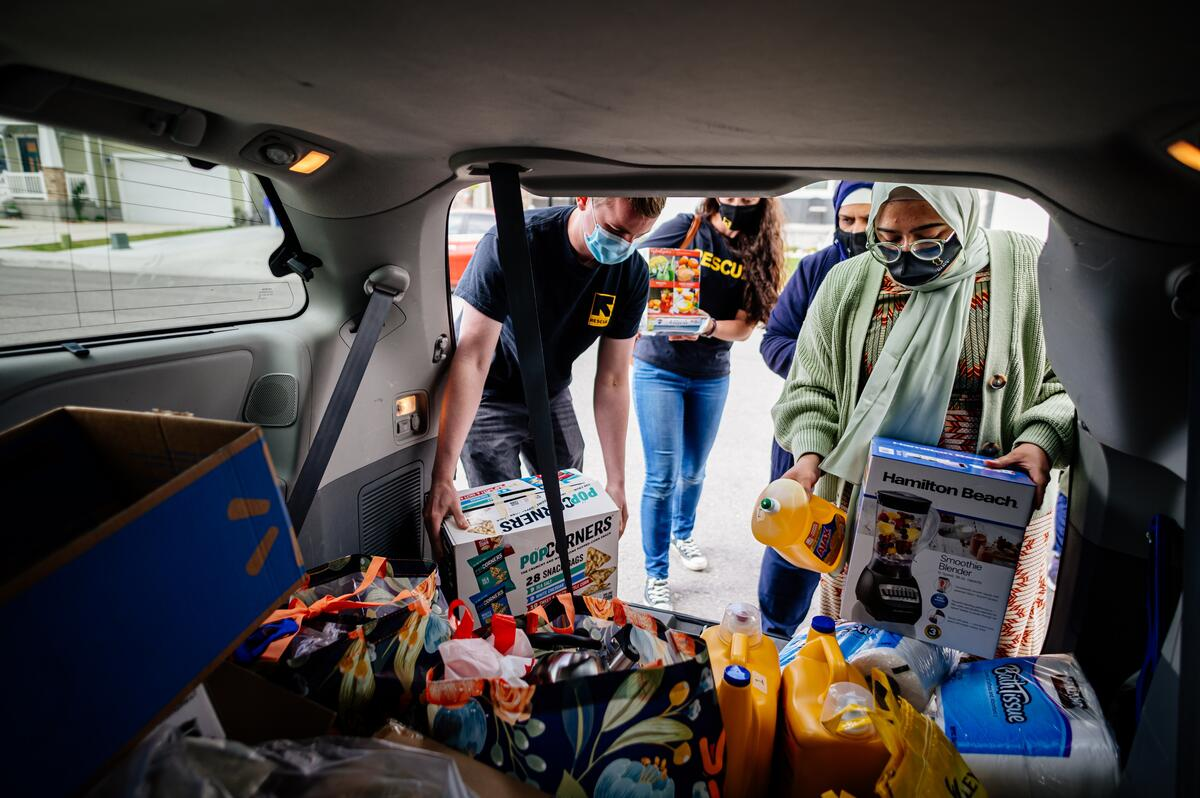 Staff from IRC of Salt Lake City and the Al-Mustafa Foudation of Utah are preparing to deliver a trunk full of gifts to refugee families celebrating Eid al Fitr