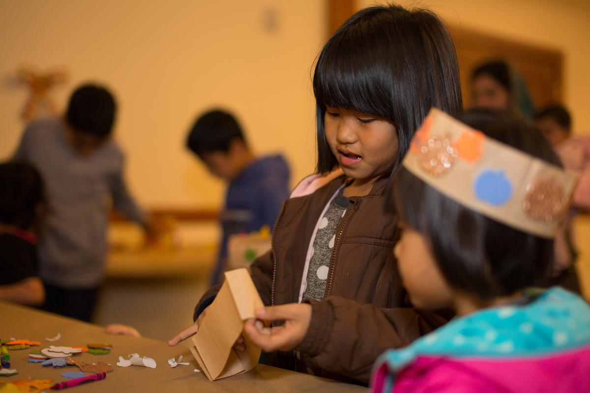 The IRC in Salt Lake City's Breaking Bread featured activities for all, including kids activities--featured, two refugee children making festive fall crowns.