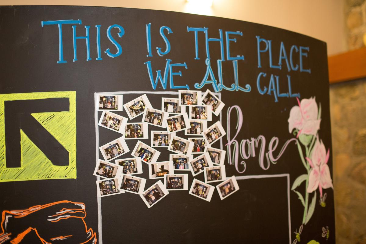 """The IRC in Salt Lake City's Breaking Bread included a Polaroid chalk wall activity displaying the """"faces of Utah"""""""