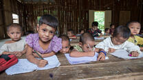 Refugee children in a classroom at a refugee camp in northern Thailand