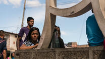 A young girl on the Simon Bolivar Bridge, Colombia. May 22, 2018.