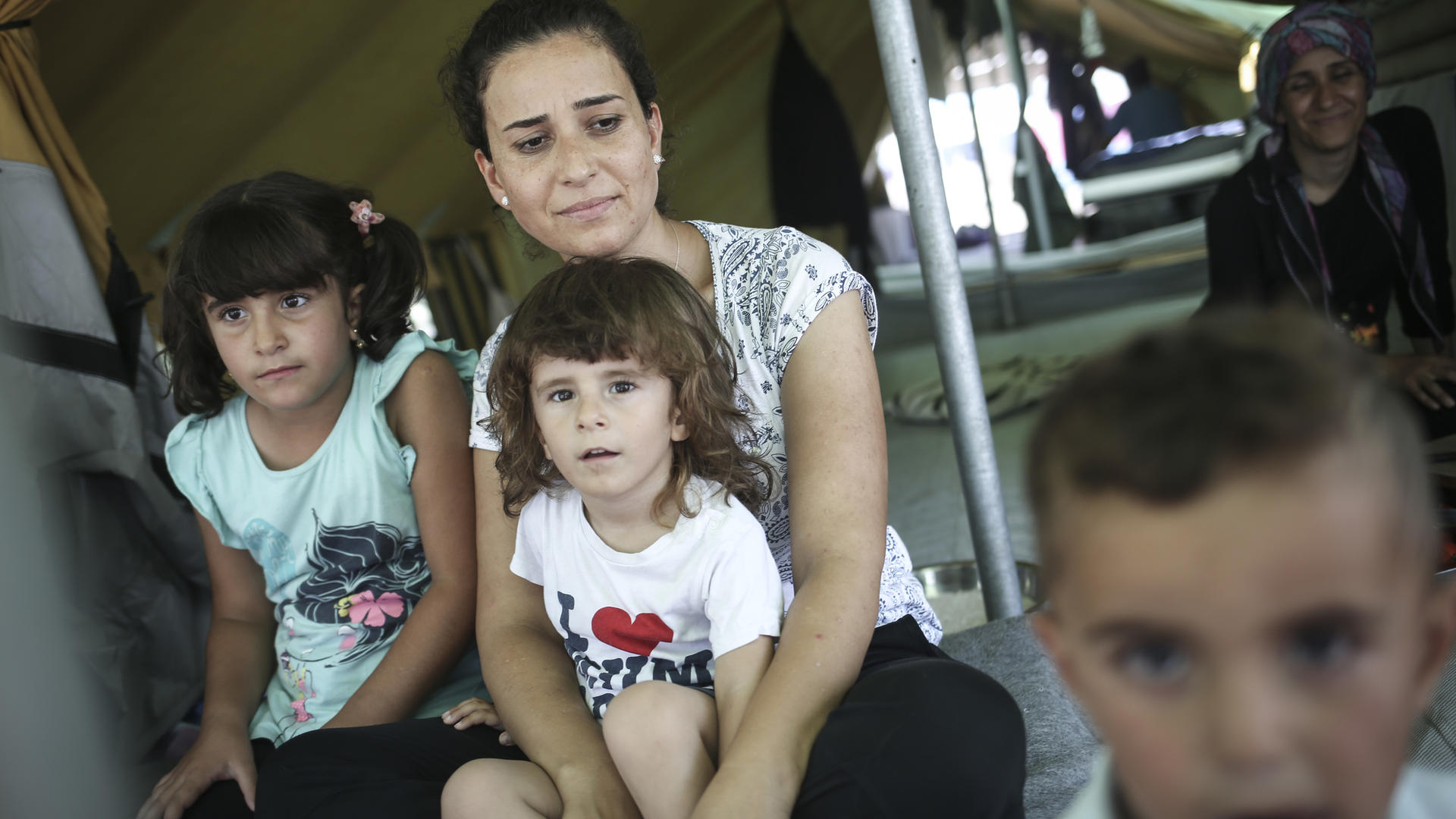 Syrian family in Alexandria refugee camp in Greece.