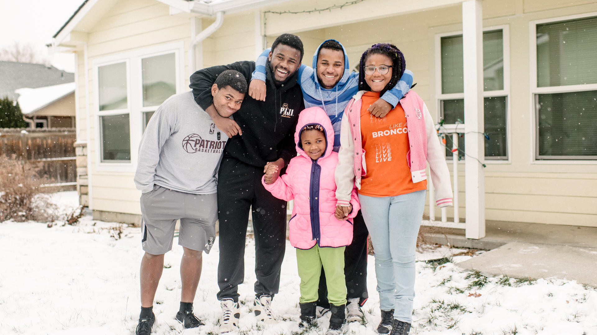 The five Ngalamulume siblings pose for a picture in the snow in their family's front yard in Boise.
