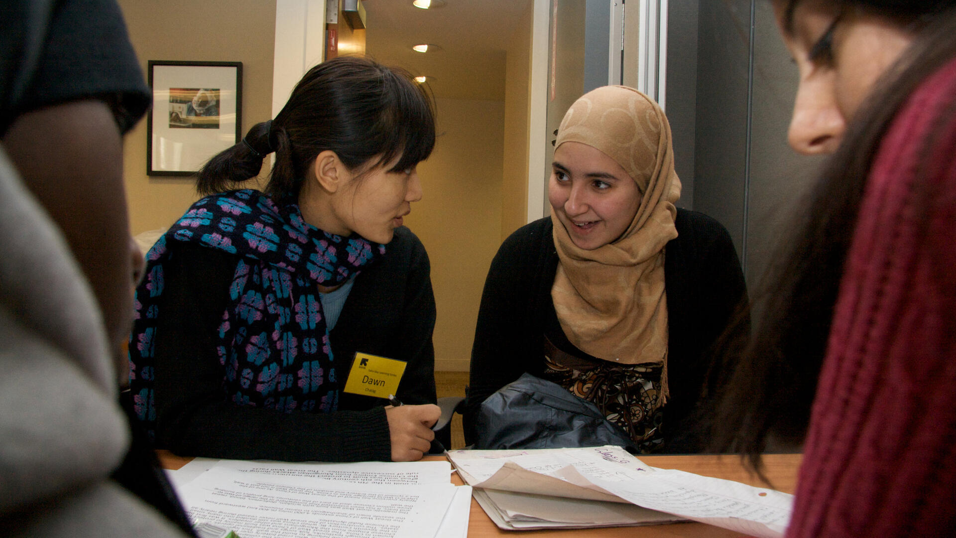 Volunteers work with refugees in an ESL class at the IRC resettlement office in New York