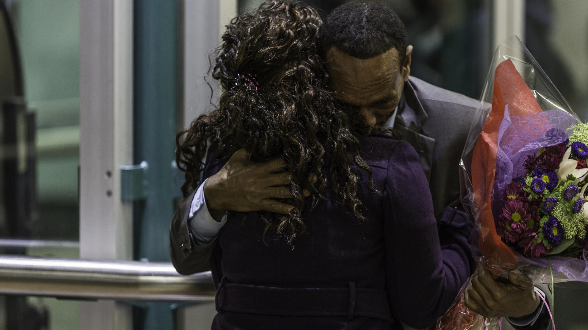 A father and daughter, Somali refugees, hug after being reunited at SeaTac airport