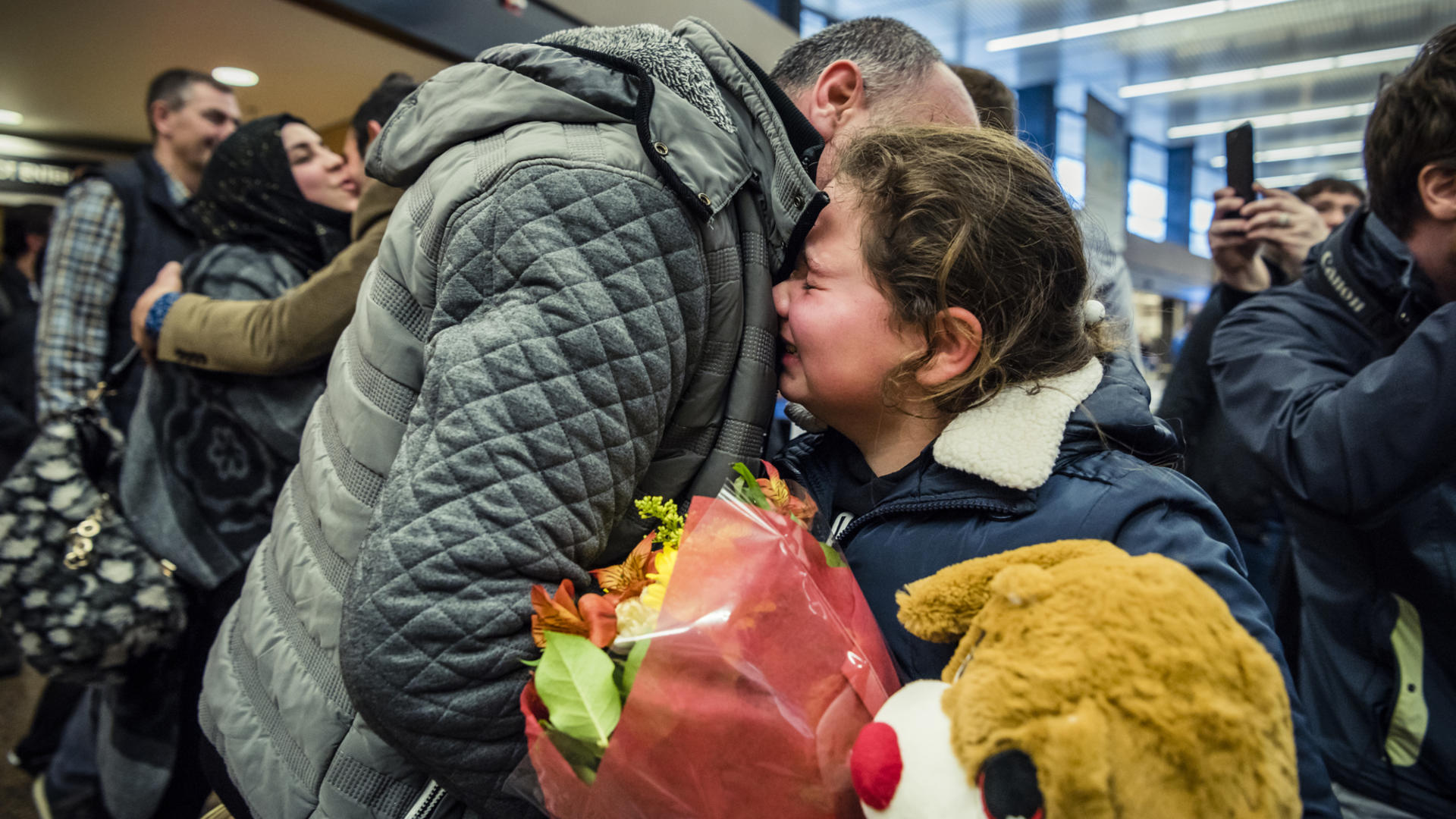 Alaa hugs her brother-in-law after he arrives at Sea-Tac International Airport