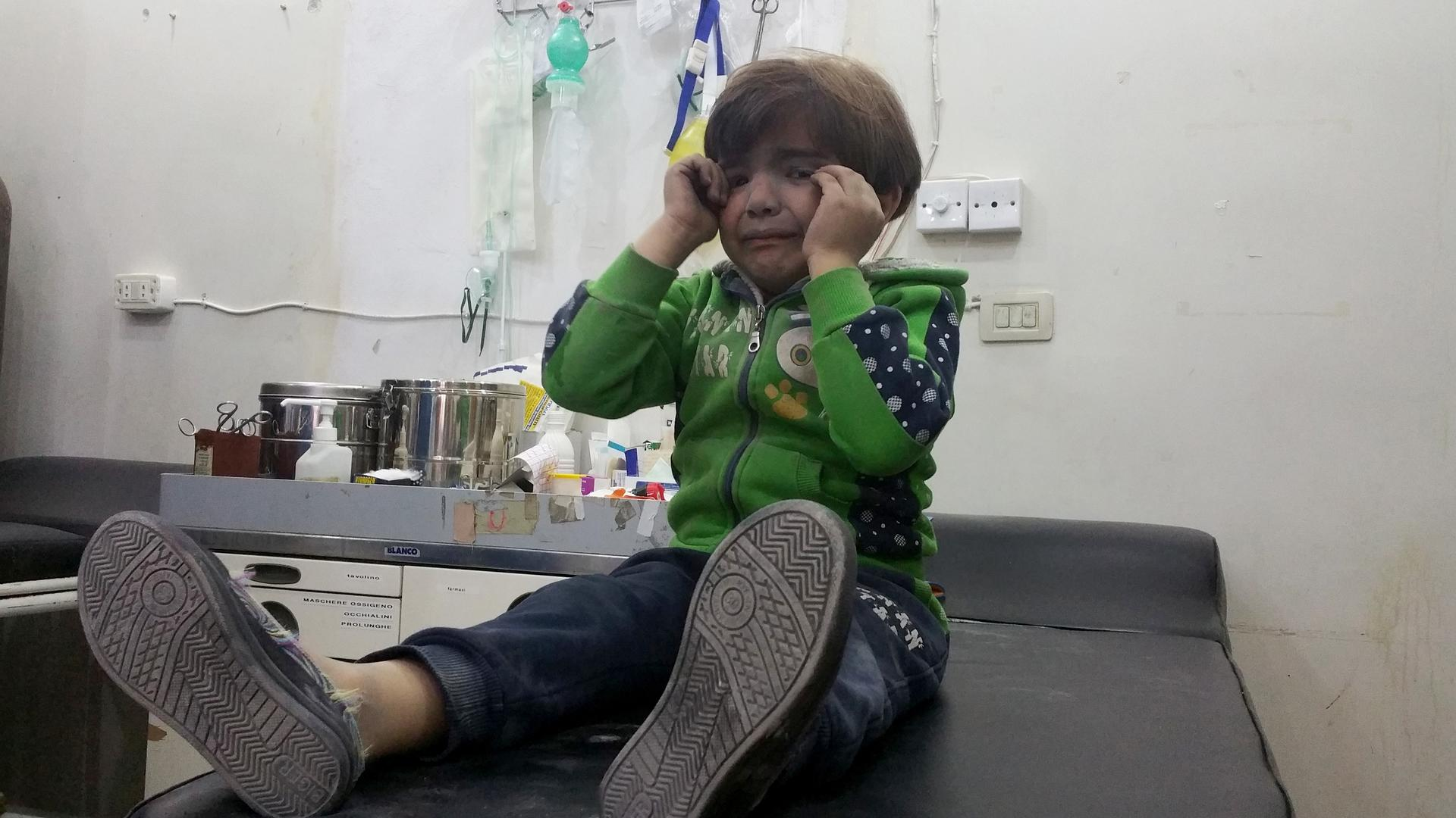 A child gets treatment at a hospital after a suspected chemical gas attack in the town of Khan Shaykhun in Idlib, Syria. Photo by Bahjat Najar/Anadolu Agency/Getty Images