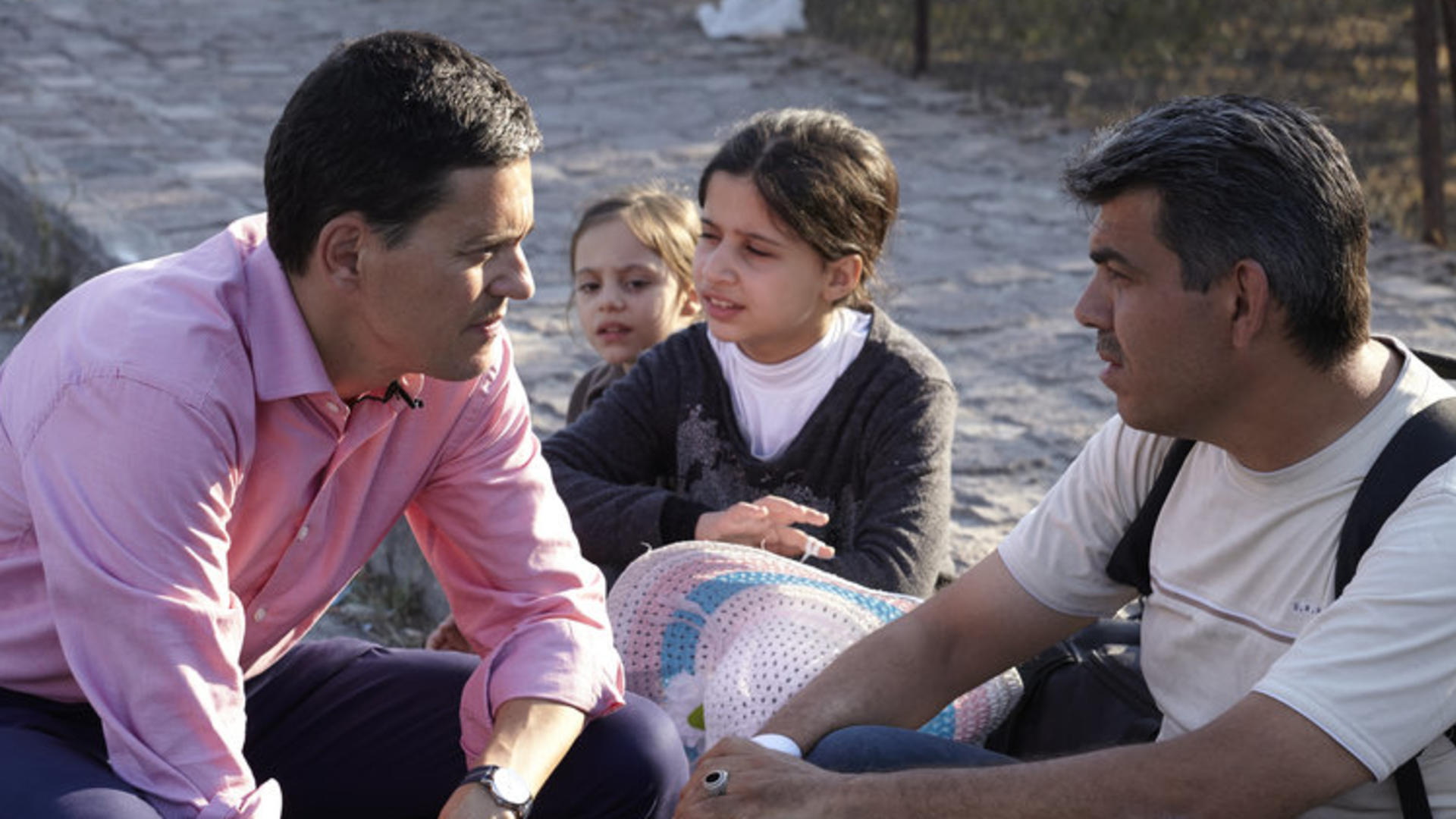 IRC president David Miliband speaks with refugees in Greece