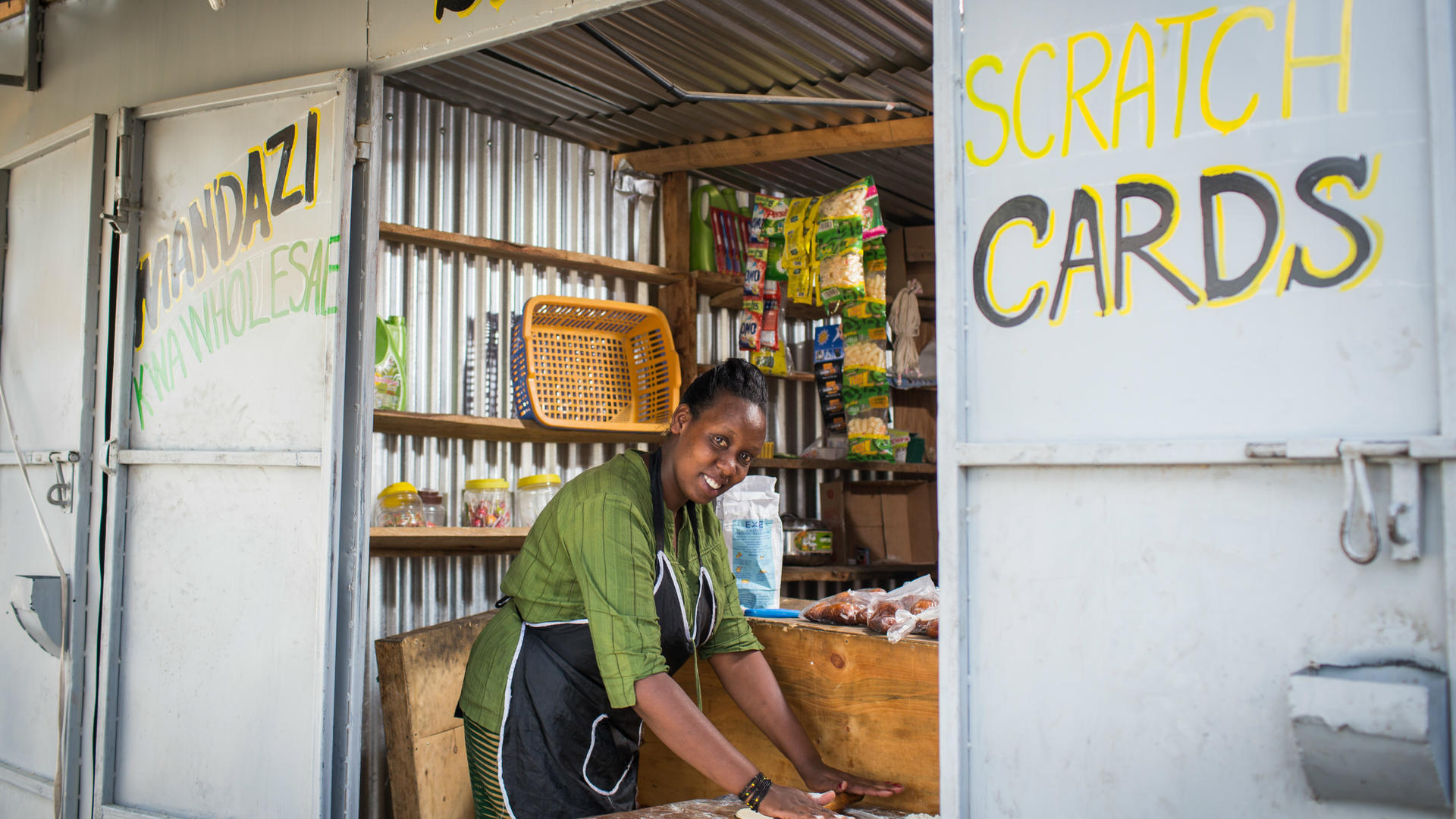 Chantal Rutonda Nyamuco makes mandazi bread at her stand in Nairobi