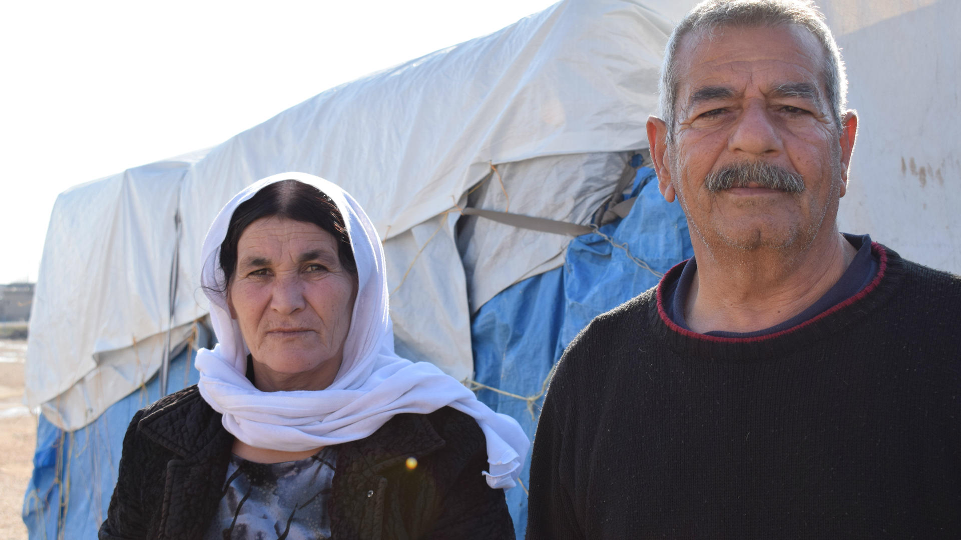Suleiman Khalf Kajo and his wife, Khabshe outside a tent in Newroz refugee camp in Syria