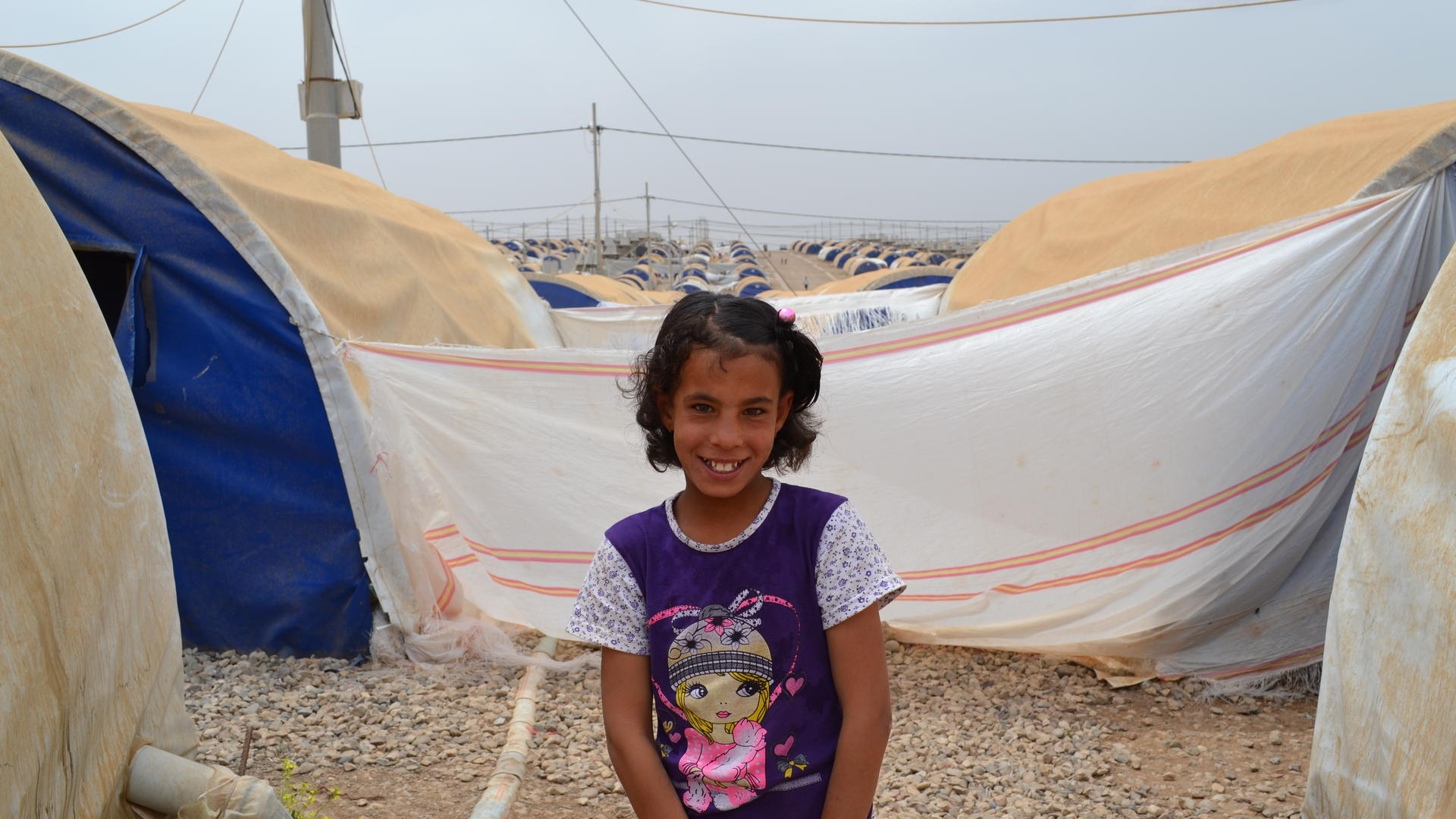 11-year-old Farah outside her family's tent in Nargazilia camp
